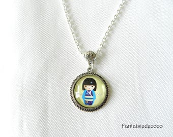 Silver plated child image fancy yellow blue kokeshi doll glass cabochon necklace