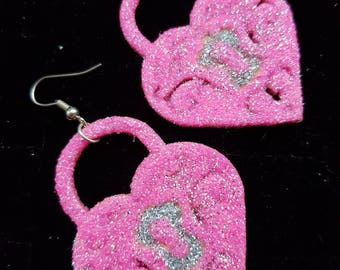 Sparkly pink heart padlock earrings made from wood and covered in glitter.