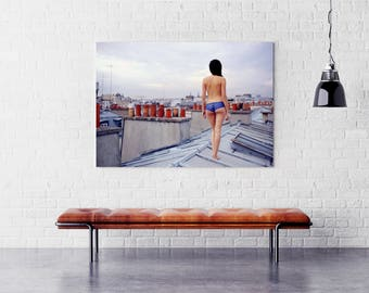 Fine art photography unusual woman pants on the rooftops of Paris, naked at sunset photography