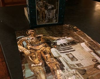 Original Star Wars jigsaw puzzle from Kenner in 1977.  C3P0 and R2D2.  Complete with all pieces and original box