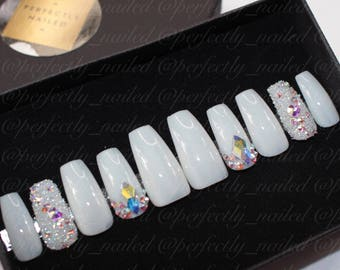 Sheer white nails with genuine crystal pixie and swarovski crystals