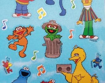 PRISMATIC glitter plastic maxi Sesame Street