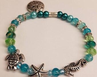 Beachy Sea Horse Stretchy Bracelet; Sea Turtle; Starfish; Seed Beads; Sand Dollar Charm;