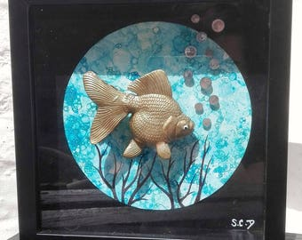 Frame gold, black and blue fish