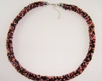 Choker necklace the colors pink, black and Brown