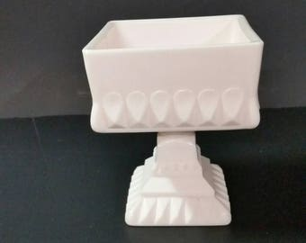 Vintage pink milk glass square pedestal bowl.