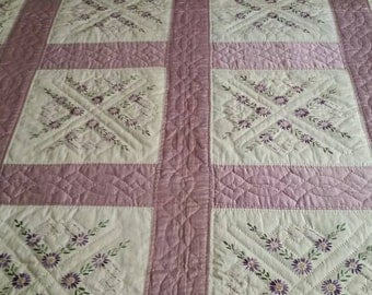 Vintage hand embroidery and hand quilted quilt.
