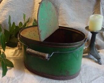 Old pool or green metal tackle box