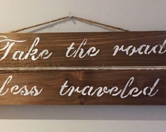 Take the road less traveled sign