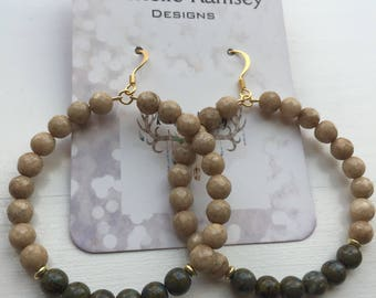 Tan/dark green beaded earrings
