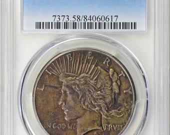 1928 Peace Silver Dollar AU 58! (Toned)