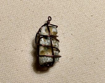 multi colored stone wrapped simply with maroon wiring