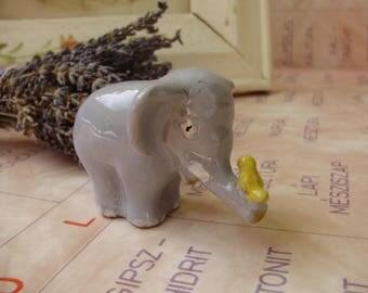 Vintage ceramic elephant with bird