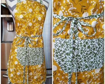 Adult apron. Woman's apron. Bright yellow and green florals and designs on main, pocket, ties and frills.