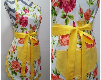 Adult apron. Woman's apron. Bright colorful floral on main.  Yellow on pocket, ties and frills.
