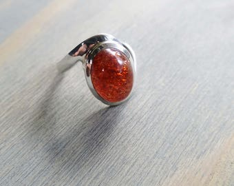 Oval Orange Cabochon Sunstone Twisted Band Ring in Sterling Silver