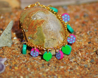 Bracelet made of fimo polymer clay green, pink, turquoise flowers and leaves