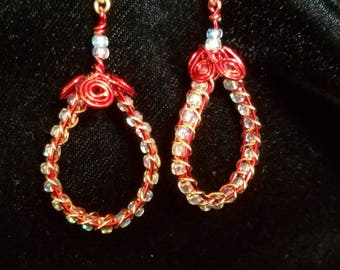 Red copper wire wrapped dangled earrings with iridescent glass beads.