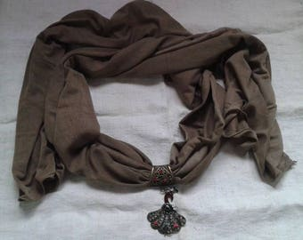 khaki scarf and its pretty Peacock jewelry