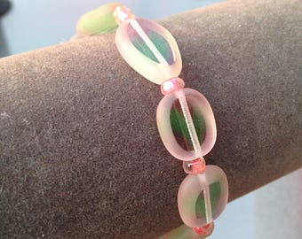 Clear pink and green glass beaded stretchy bracelet