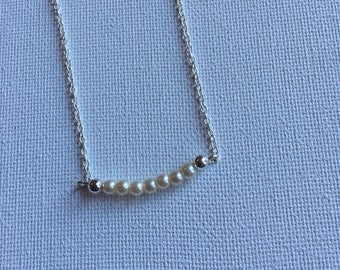 "White pearls on an 18"" sterling silver chain.  Minimalist necklace."
