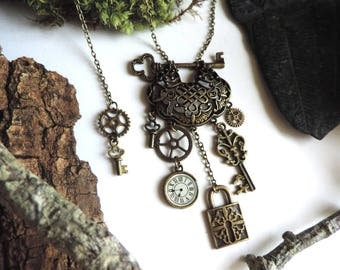 """"""""""" Bronze """"key of time"""" Necklace: pendulum, key, lock and gears."""