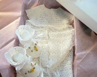 A crocheted christening ensemble: gown, shoes, and bonnet.