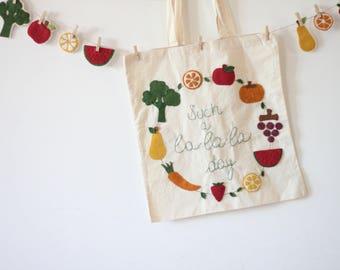 la-la-la-day bag: hand embroidered canvas tote bag with cloth applications