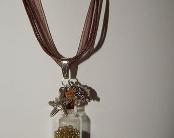 Topped with mini glass bottle pendant bead gold