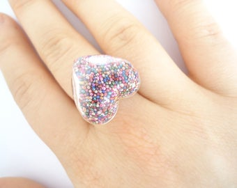 Ring with multicolored micro glass heart
