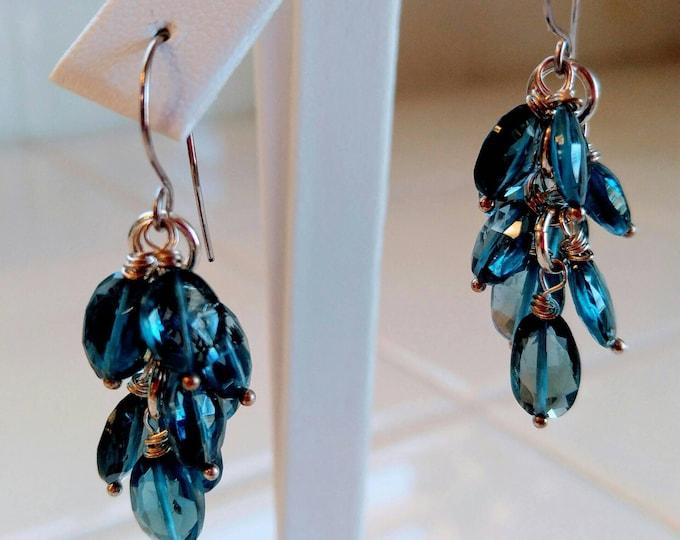 London blue topaz earrings. Topaz dangle earrings. 14k white gold, london blue chandelier earrings. Blue and white,  long cluster earrings