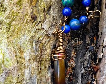 Titanium quartz crystal point pendulum necklace