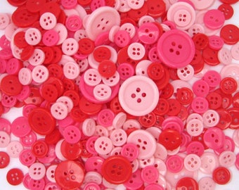 152 buttons - mixed assorted colours - red - dark pink - light pink - 4 different sizes
