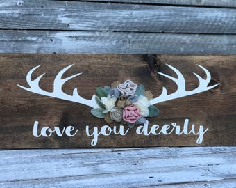 love you deerly rustic wood sign with floral embellishments