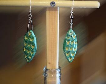 metallic emerald green and gold, leaf shaped sculptured earrings, dangle earrings, silver plated hooks