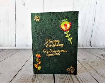 Lovely rich evergreen coloured birthday card with pretty flowers.