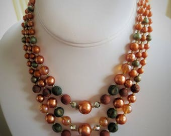 Vintage Multi Strand of Graduated Beaded Necklace Pearly Orange, Copper, Gold, Olive.