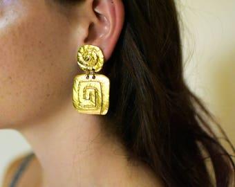gold spiral drop earrings