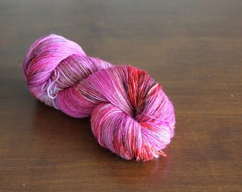 Handdyed yarn, sock yarn, fingering weight, yarn, socksanity, socksanity aphrodite, pink yarn, pink, purple