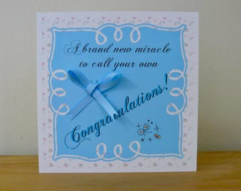 "Individual 140mm Square Blank New Baby Card ""A brand new miracle to call your own, Congratulations!""  With Satin Bow & Acrylic Gems"