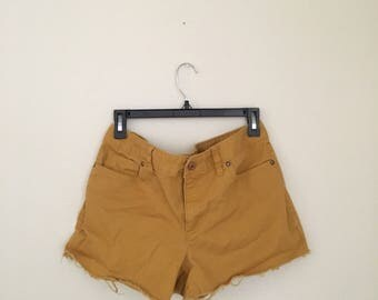 mustard colored high waisted denim shorts