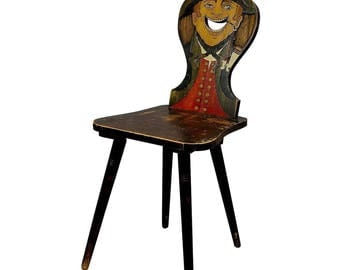 a carved and painted rural chair ca. 1910