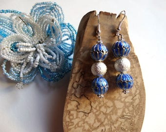 Blue silver and sparkling earrings dangling - year celebrations