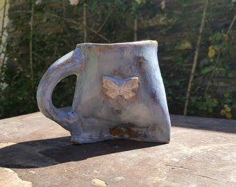 Fat belly tripod mug with single butterfly