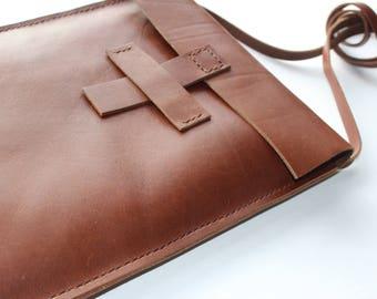 handmade  leather convertible bag.