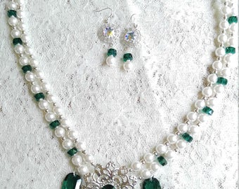 Pearl and emerald crystals