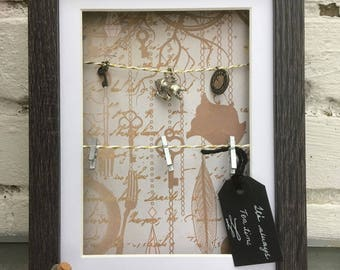 Alice in Wonderland memo board in frame box, hanging photos, cute drink me bottle, Alice charms
