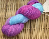 Broken Violet Fingering Weight Yarn (70/25/25 Merino Wool / Alpaca / Nylon) hand dyed in bright fuchsia, sky blue, and purple