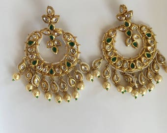 Gold finish kundan chandbali earrings with dangling pearls