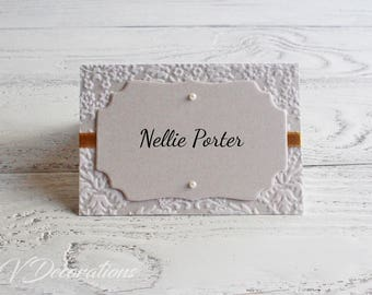 Luxurious place cards with pearls and gold ribbon